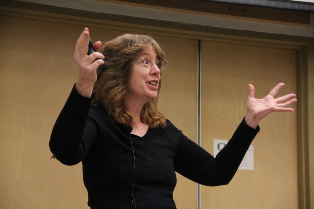 "SLAC's JoAnne Hewett gives her rendition of the dark matter rap, repeating the refrain: ""Dark matter: what is it?"".  Image: Jack Liu."