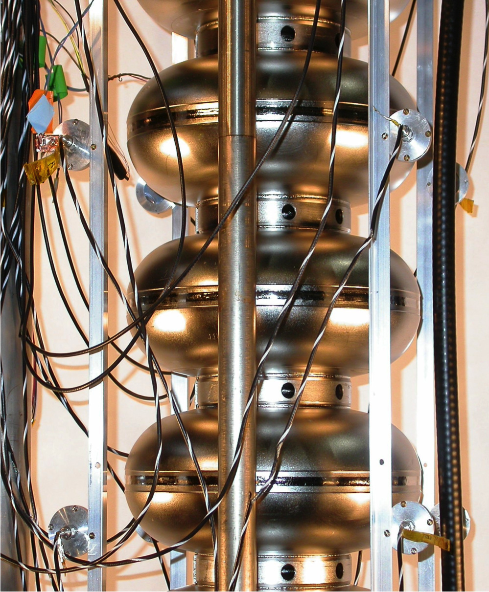 An ILC-type cavity soon to be tested for defects using second-sound detection. The sensors, oscillating super-leak transducers, are the small metal discs connected to cables. Image: Zach Conway.