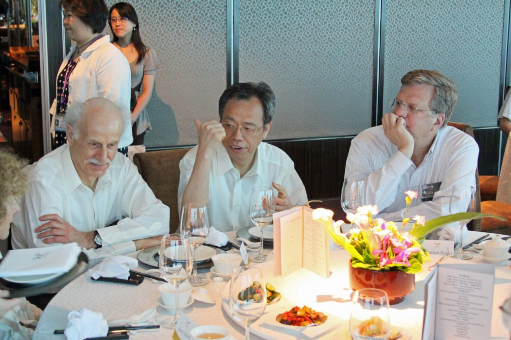 """Our host Shih Chang (S.C.) Lee hosted a banquet at """"101,"""" until recently the world's tallest building. He is sitting between Roy Rubinstein, PAC secretary, and Jon Bagger, ILCSC chair."""