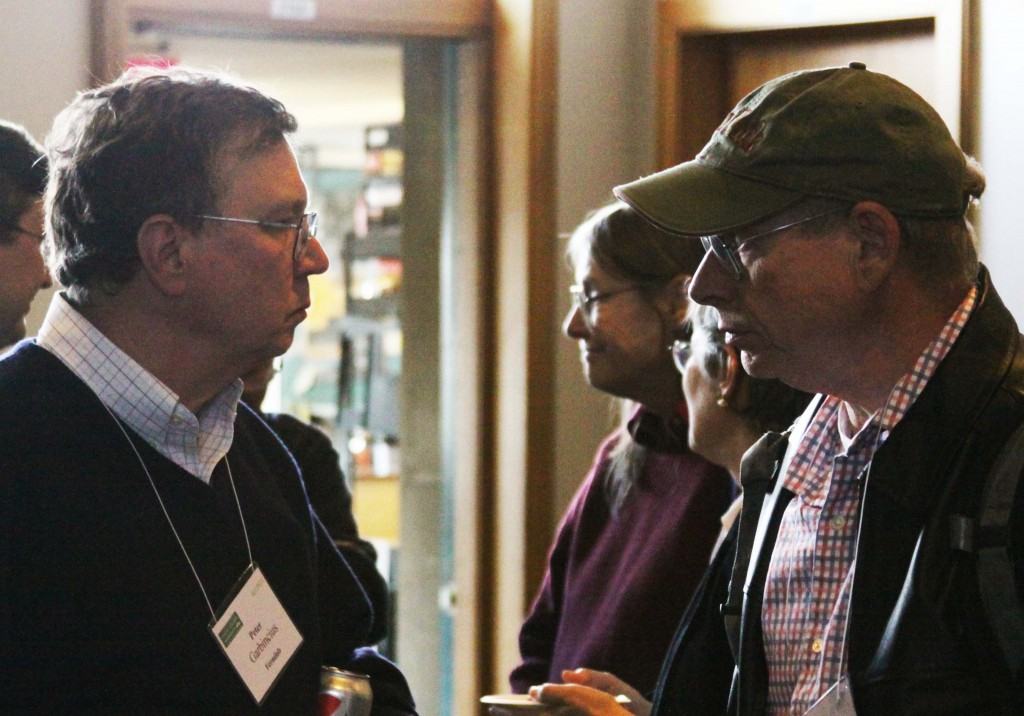 Peter Garbincius in discussion with Gerry Dugan during Baseline Assessment Workshop at SLAC