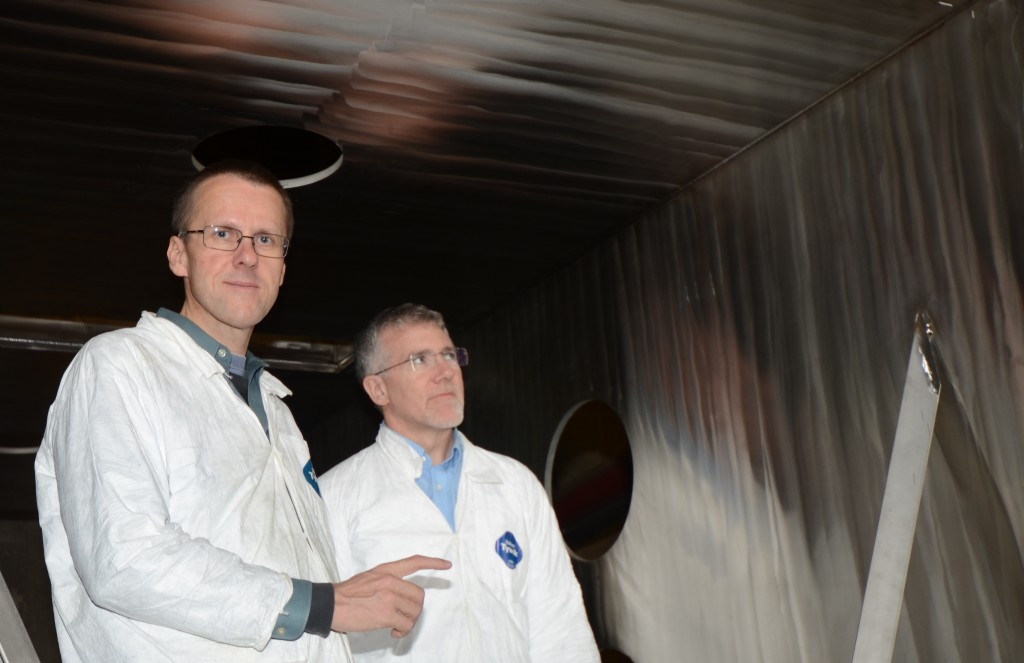 PAVAC President Ralf Edinger (left) and associate Doug LaPointe inspect a vacuum chamber the company is manufacturing for an electron beam welder. Image: Ralf Edinger