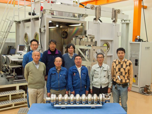 KEK researchers stand behind cavity zero, most of which was processed in the laboratory's Cavity Fabrication Facility. Image: Nobuko Kobayashi
