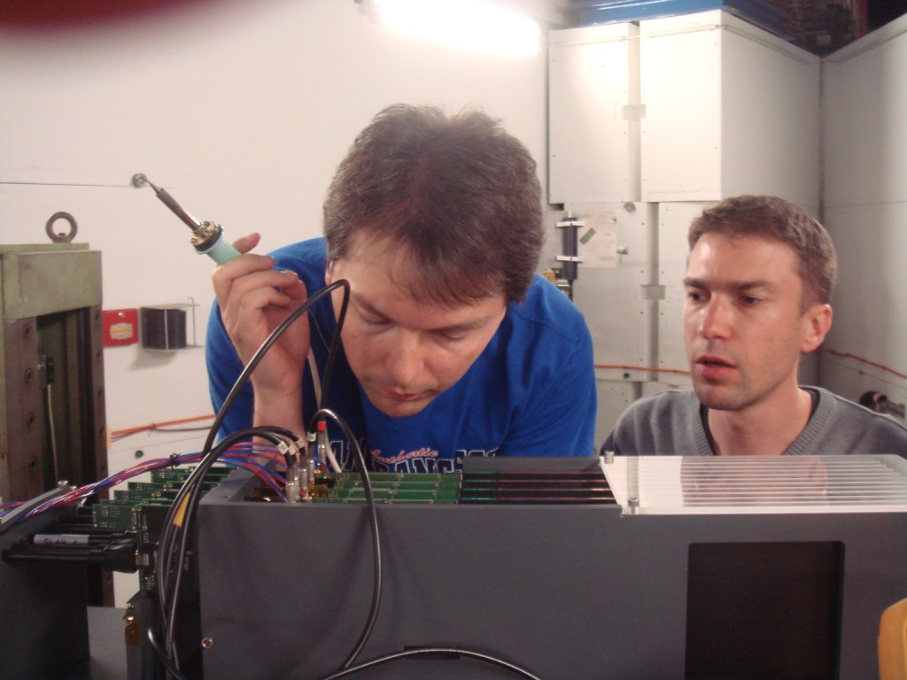 LAL engineers Stephane Callier and Remi Cornat setting up the SiW electromagnetic calorimeter.