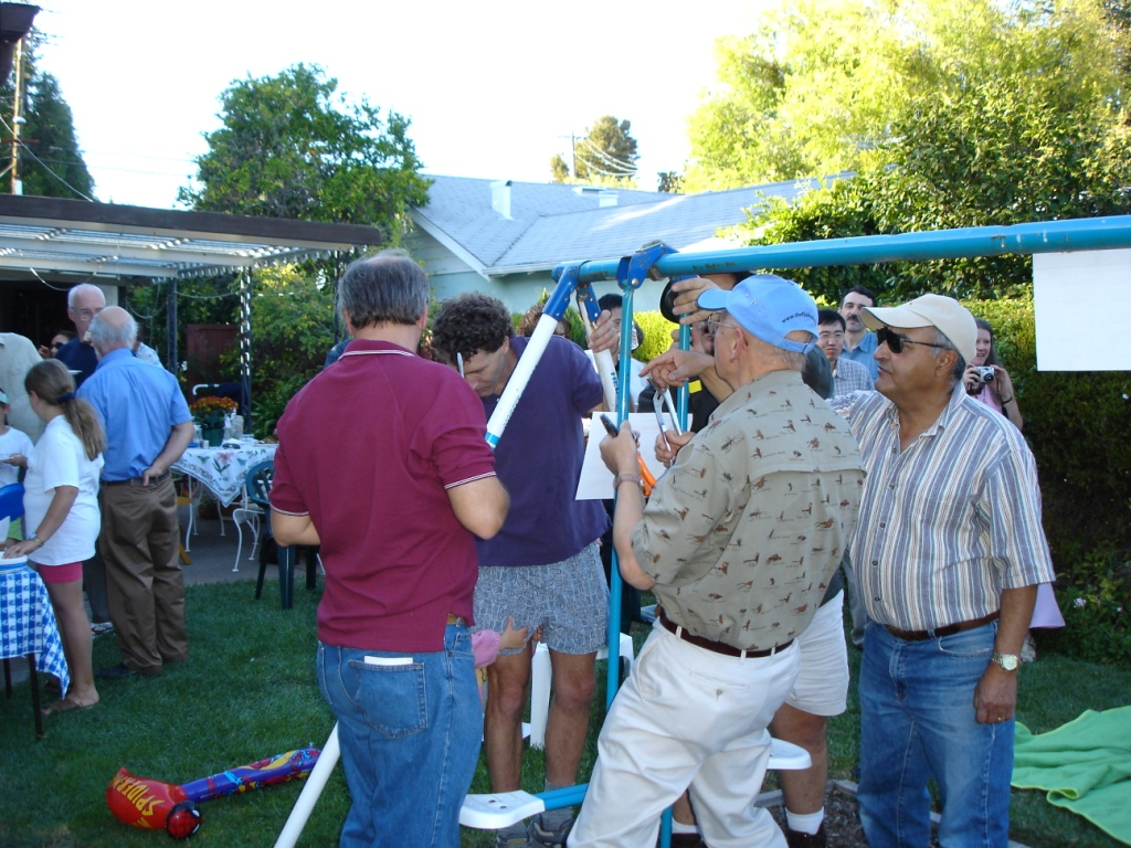 SLAC physicists and engineers dismantle Spencer's NLC-labeled swing set at her 2004 Goodbye NLC party. Image: Naomi Nagahashi