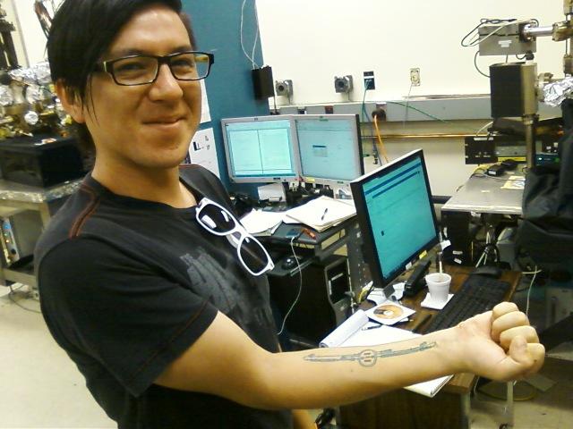 Gabriel Palacios shows off his ILC tattoo at his Jefferson Lab office. Photo: Matt Poelker