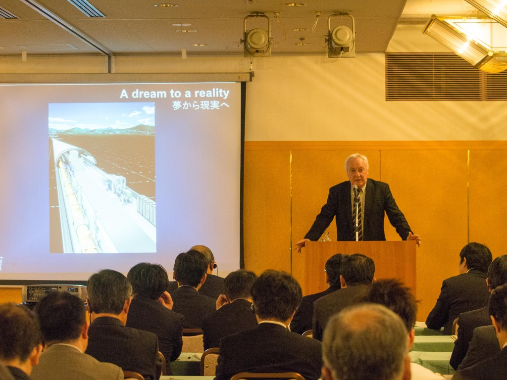 Lyn Evans giving a talk at AAA's special lecture in Tokyo. Image: AAA