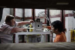 Summer students Torben and Manuel adjust the setup of the beam telescope. Image: DESY, Nina Laskowski