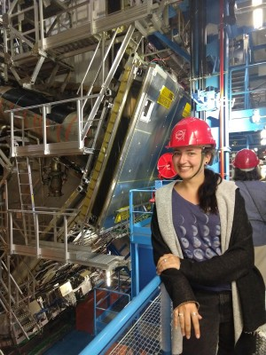 Amanda Steinhebel stands near the ATLAS detector at CERN's Large Hadron Collider.