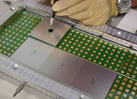 Placing wafers on PCB for the CALICE Collaboration