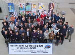 Participants pose in front of ILC support banners in the ILD meeting venue.